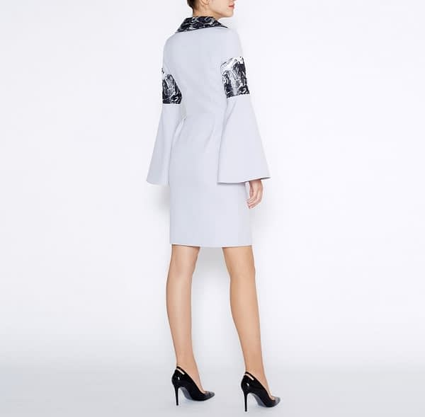 Sheath dress made of nude grey suiting fabric, adorned with a marbled jacquard collar and flared sleeves.